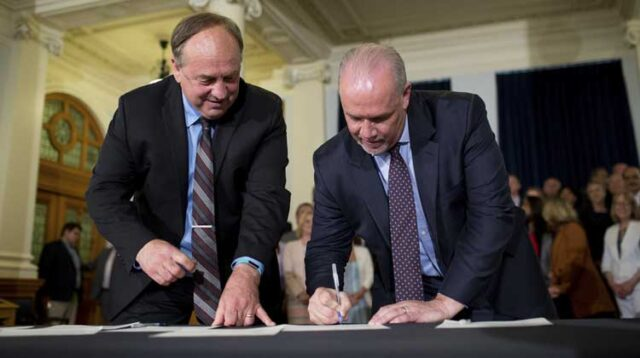 John Horgan and Andrew Weaver Sign the 2017 Confidence and Supply Agreement that Made Horgan Premier of BC